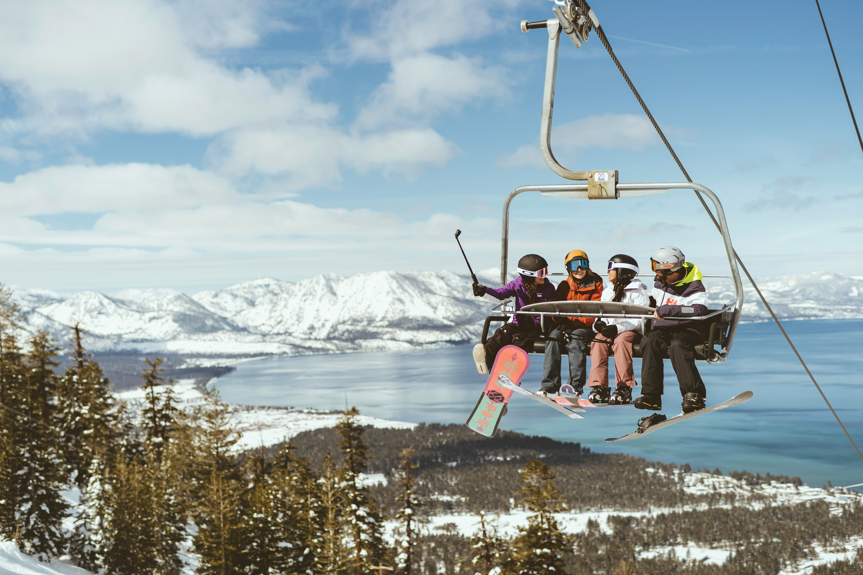 Skiers on a chairlift at Heavenly, California