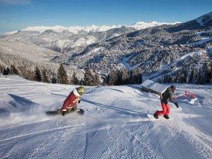 Snow boarding the groomed runs at Meribel Ski Resort, France